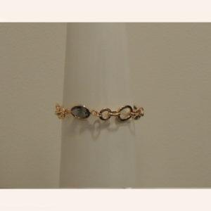 Bracciale dorato con pietra